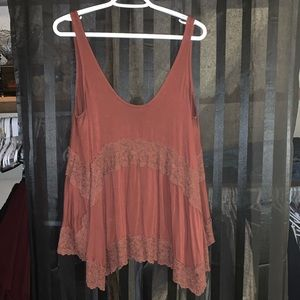 Sm (but fits an XL sleeveless American Eagle top